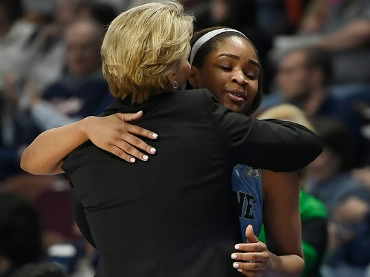 Tulane's Kolby Morgan, right, is hugged by head coach Lisa Stockton as she leaves the court during the second half of an NCAA college basketball game against Connecticut in the American Athletic Conference tournament quarterfinals at Mohegan Sun Arena, Sunday, March 4, 2018, in Uncasville, Conn. (AP Photo/Jessica Hill)