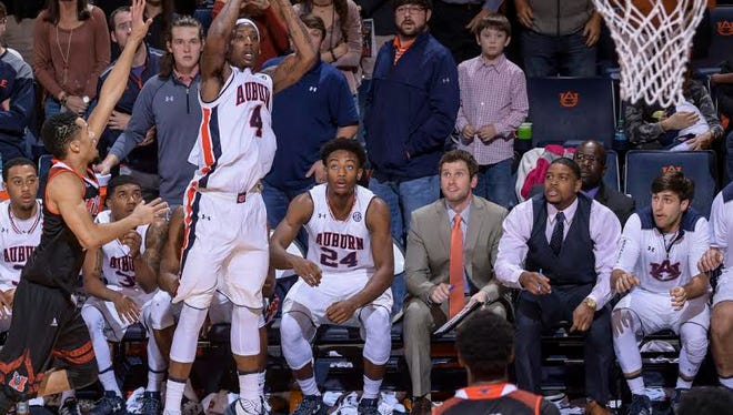 Auburn guard T.J. Dunans hits a game-winning 3-pointer at the buzzer to save a 76-74 win over Mercer on Dec. 18, 2016.