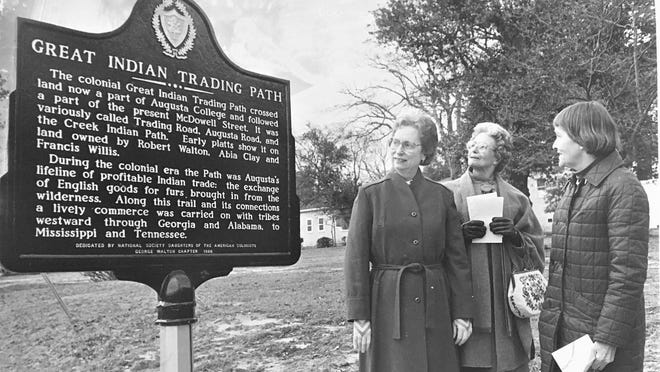The 1986 dedication of the Indian Trail marker at Johns Road and McDowell Street is observed by Lois Pietrowski (from left), Virginia de Treville and Marguerite Fogleman.