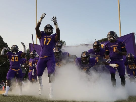 Hattiesburg High takes the field before Friday's home game against Moss Point.