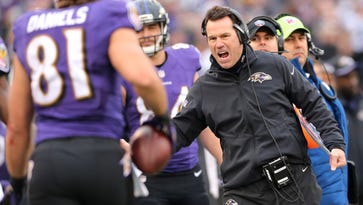 Dec 14, 2014; Baltimore, MD, USA; Baltimore Ravens offensive coordinator Gary Kubiak congratulates tight end Owen Daniels (81) after his touchdown catch against the Jacksonville Jaguars at M&T Bank Stadium.