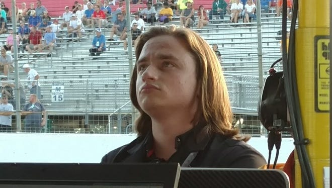 Team owner George Michael Steinbrenner IV watches a monitor during Saturday night's Indy Lights race at Gateway Motorsports Park. His driver, Colton Herta, finished third.