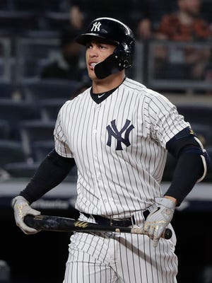 New York Yankees' Giancarlo Stanton reacts after striking out against the Miami Marlins during the eighth inning of a baseball game Tuesday, April 17, 2018, in New York. (AP Photo/Julie Jacobson)