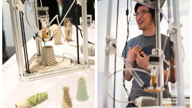 Taek Lee talks with people and demonstrates his use of a 3D printer during an art showing for a monthlong exhibition at the Thomas Riley Studio in Naples, Fla., on Thursday, April 13, 2017. Taek Lee, is a 3D artist who creates his works on a computer.