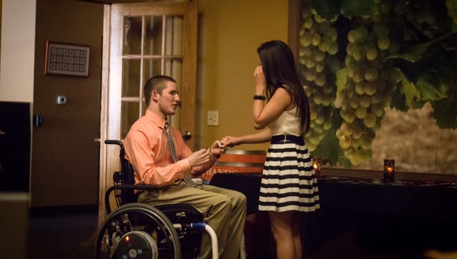 Chris Norton proposes to girlfriend Emily Summers on Saturday night at their favorite restaurant, Rubaiyat in Decorah.
