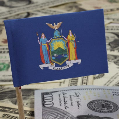 Flag of New York sticking in various american banknotes.(series)