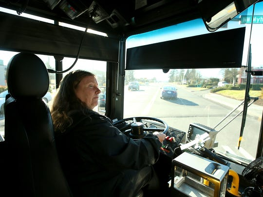Kitsap Transit driver Valerie Quill drives her Silverdale