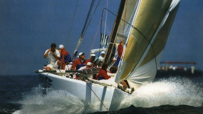 The crew of America 3 sails past a mark during the America's Cup defender series finals off San Diego in 1992. America 3, skippered by Buddy Melges on Zenda, Wis., defeated Stars & Stripes by 2:09 in the opening race of the best-of-13 finals.