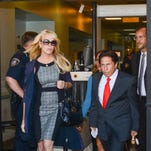 Dina Lohan appears in court with attorney Mark Heller on Sept. 24 in Hempstead, N.Y.