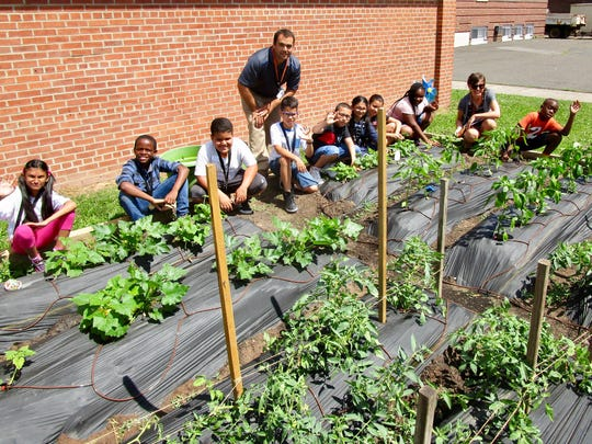 School No. 2 students and staff in their garden on