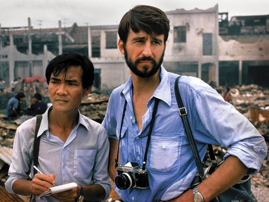 Reporter Sydney Schanberg, right, (played by Sam Waterston) relied on Cambodian Dith Pran (played by Haing S. Ngor, who won an Oscar) to get his story for The New York Times.