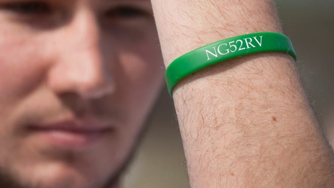 Jacob Sadlier, a senior member of the Rancocas Valley boys' lacrosse team, who lost his friend and teammate Nicky Green to suicide in 2012, displays his wrist bracelets with Green's initials and the number 52 on it, prior to a boys' lacrosse game on Thursday. The group of Rancocas Valley seniors who starting playing lacrosse with Nicky in middle school have dedicated their final season together to Green, the one who brought them all together. 04.02.15