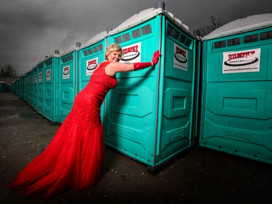 Jill Bell learned portable toilets had been delivered to the Belvedere instead of the riverfront. So as the vice president of marketing for the Kentucky Derby Festival in the late 1980s, she went to move the bathrooms - still dressed in her finery from an evening out. (Rumpke, the company that provided the equipment for this photo, was not the company involved in the mistake back then.) April 11, 2017