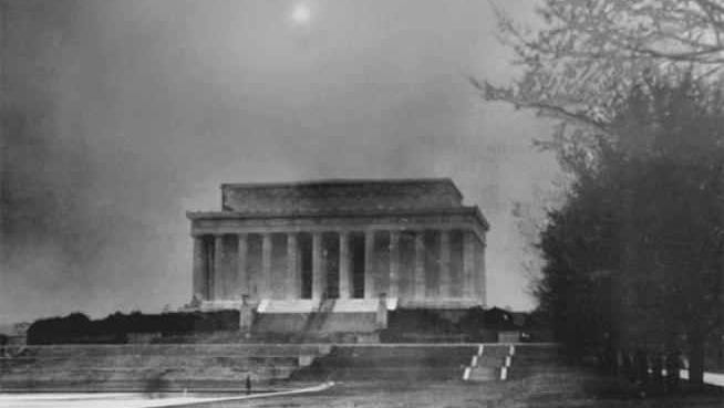 The Lincoln Monument in Washington D.C. engulfed in a dusty haze nearly blotting out the setting sun on March 21, 1935.