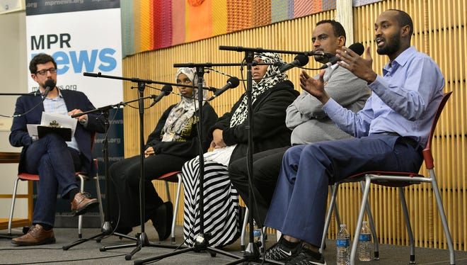 """Tom Weber of MPR listens as St. Cloud Somali community member Hassan Yussuf talks about his experience living in St. Cloud on Thursday, Jan. 28 during a Minnesota Public Radio News-sponsored community conversation titled """"Muslims in Minnesota"""" at the St. Cloud Public Library."""