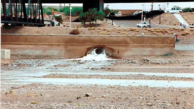 On June 2, 1999, after nearly two years of transforming the Salt River channel into Tempe Town Lake nearly 1 billion gallons of water began flowing into the cavity – at the precise spot where water just completed refilling a newly dammed Town Lake.