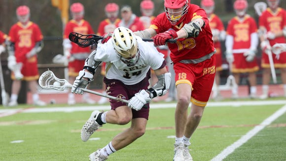 Iona's Jack Heffernan (14) gets hit by Chaminade's
