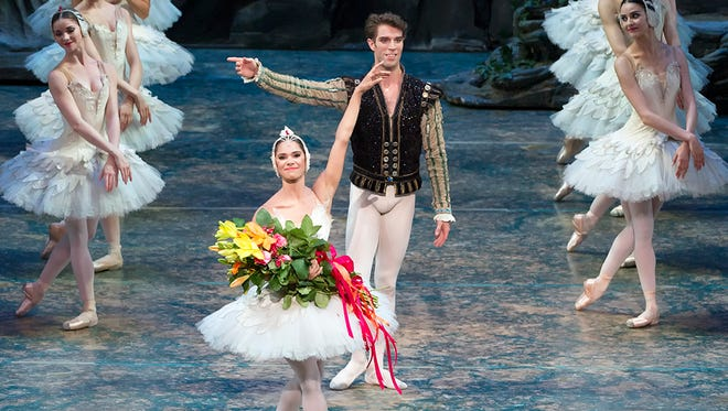 Misty Copeland and James Whiteside acknowledge the applause after their triumphant 'Swan Lake' at the Metropolitan Opera House in New York on June 24, 2015.