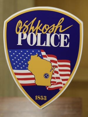Oshkosh Police Department logo decal on a window