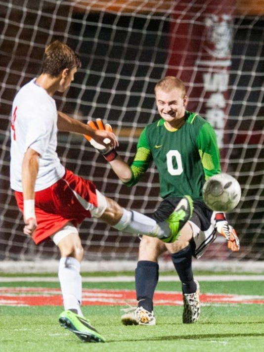 Susquehannock senior Alex Rebich (4) beats Gettysburg goalie Michael Heeschen (0) in the second half during a boys soccer game on Thursday, Sept. 11, 2014. Susquehannock won 3-1.