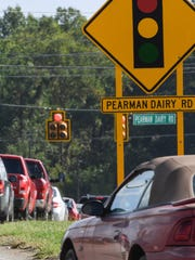 Cars drive to Pearman Dairy Road, also known as State Highway 28 Bypass in Anderson, from Old Pearman Dairy Road.