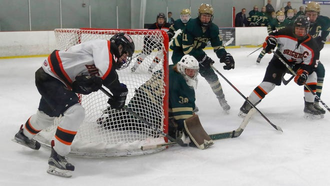 Adam Conquest (left) and the Brighton hockey team will begin its state championship defense at 7:30 p.m. Monday, Feb. 26 against Howell at the Kensington Valley Ice House.