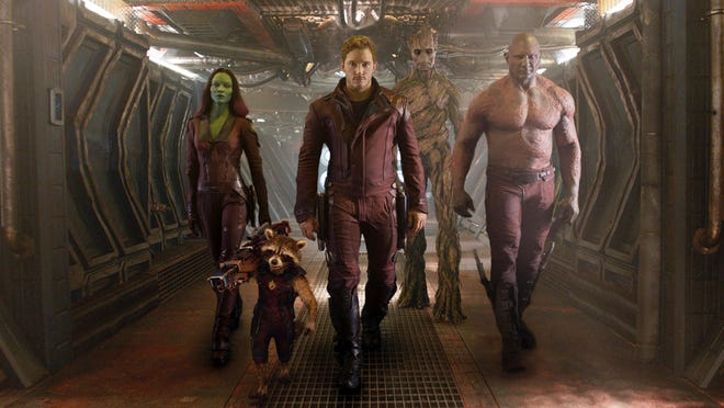 """Zoe Saldana, the character Rocket Racoon (voiced by Bradley Cooper), Chris Pratt, the character Groot (voiced by Vin Diesel) and Dave Bautista star in """"Guardians of the Galaxy."""""""