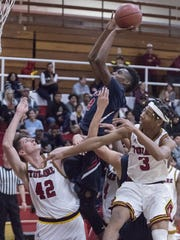 Tulare Western's Deeandre Hulett shoots against Tulare