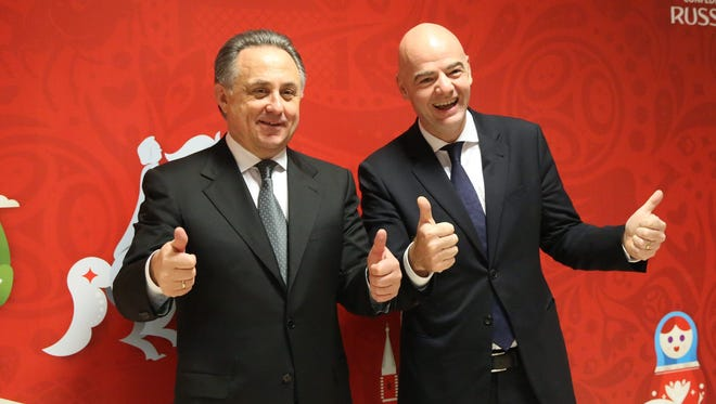 Russian Deputy Prime Minister Vitaly Mutko (L) and FIFA President Gianni Infantino prior to the draw of the FIFA Confederations Cup 2017 in Kazan, Russia on November 26.