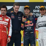 Ferrari's Spanish driver Fernando Alonso, Red Bull Racing's trackside control engineer Michael Manning, Red Bull Racing's German driver Sebastian Vettel and Mercedes'  British driver Lewis Hamilton celebrate on the podium at the Spa-Francorchamps ciruit in Spa on Aug. 25, 2013 after the Belgium Formula One Grand Prix.