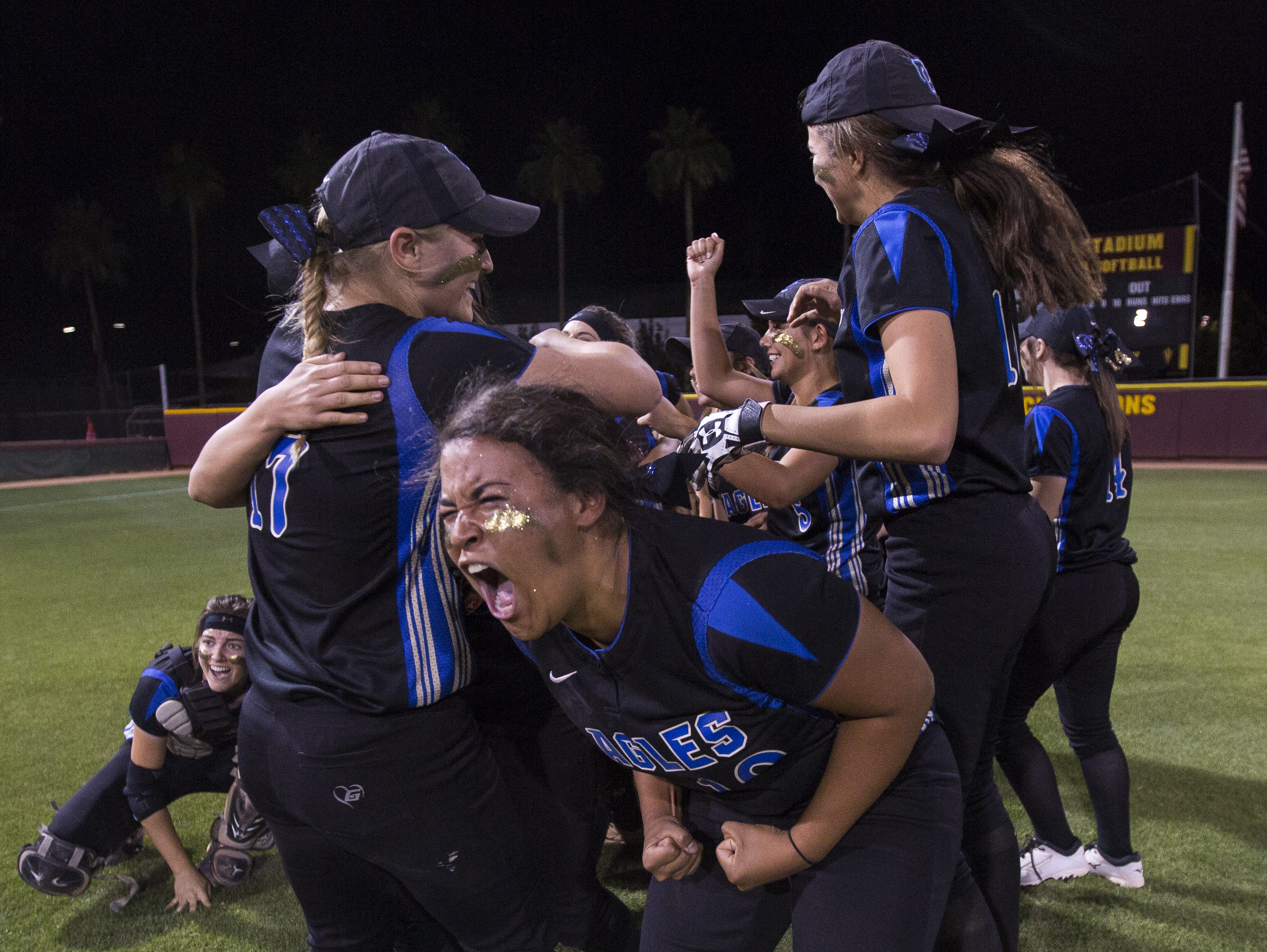 Sandra Day O'Connor's Justyce McClain (10) screams with her team celebrating their D1 State Softball Championship win over Mountain Ridge at Farrington Softball Stadium in Tempe, AZ on May 18, 2015.