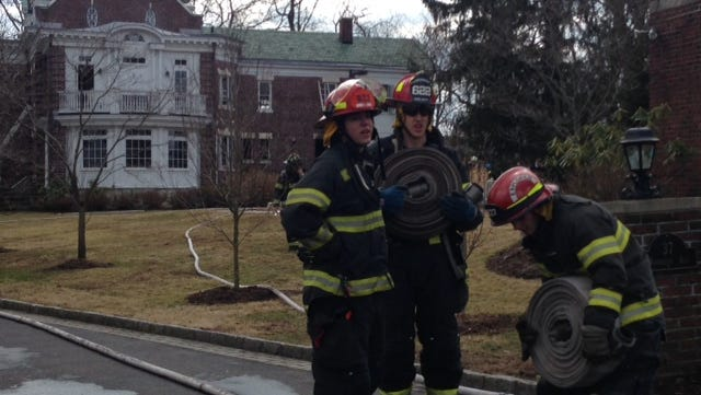 Firefighters at the scene of a kitchen fire at 37 Woodbine Ave. in Larchmont in which two workers were burned. March 20, 2014.