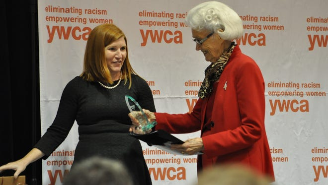Katie Vanderlick, executive director at the YWCA of Alexandria-Pineville, presents a Distinguished Women of the Year award to Vesta Mangun during the 2015 Decades of Women luncheon.