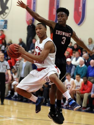 Brentwood Academy's Tyler McNair (#24) shoots a basket while being guarded by Jordan Bone of Ensworth during their game Tuesday January 12, 2016 at Brentwood Academy.