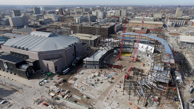 A reader suggests that instead of tearing down the the BMO Harris Bradley Center (at left), it be renovated to house the Milwaukee Public Museum. The new arena for the Milwaukee Bucks is rising on the right.
