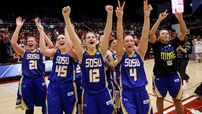 South Dakota State players celebrate after a 74-71 win over Miami in a first-round women's college basketball game in the NCAA Tournament Saturday in Stanford, Calif.