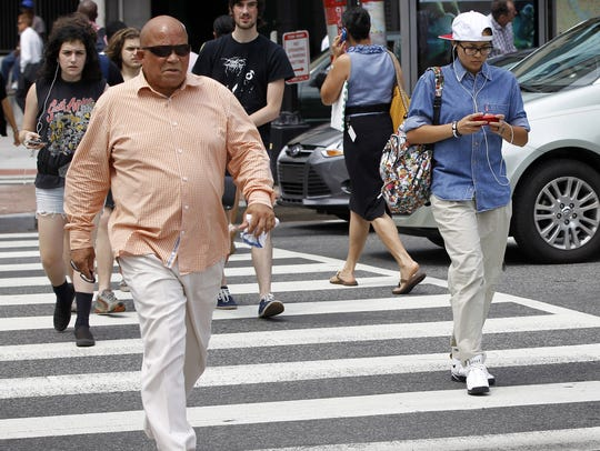 New York is considering a ban on texting and walking across the street.