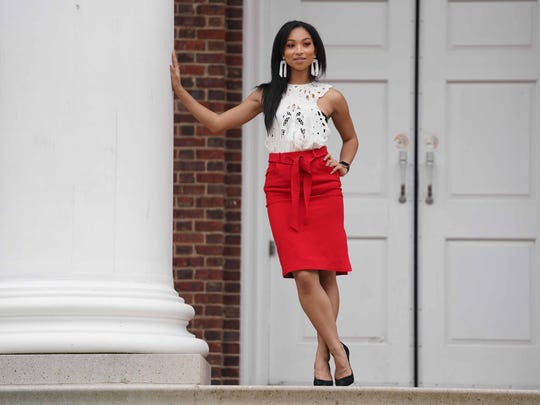Chelsea Bruce wears red pencil skirt from Banana Republic;