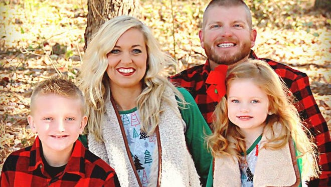 Bruceton assistant coach David Thomas and his wife Amanda have two children.
