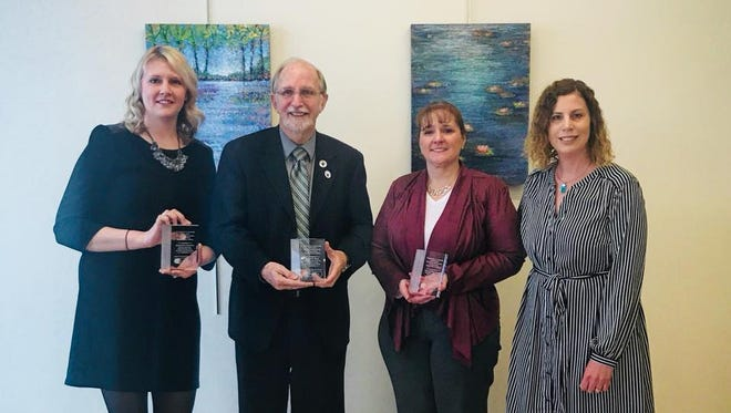 The 2018 Outstanding Achievement in Supporting Sexual Assault Victims Award winners, from left, Jacqueline Gremler, Ralph Uttke and Pam Steffen Karls stand with Jessica Lind of The Women's Community on April 16 at the Center for the Visual Arts in Wausau.