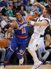 New York Knicks guard Frank Ntilikina (11) battles Dallas Mavericks guard J.J. Barea (5) for space during the first half of an NBA basketball game Sunday, Jan. 7, 2018, in Dallas. (AP Photo/Brandon Wade)