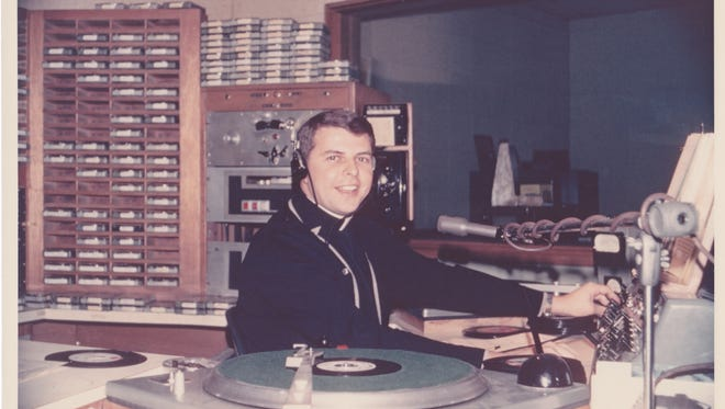 "Father Harry Schlitt applied his love of music to a radio show in Springfield called ""I'll Never Tell"" on KICK. It was the beginning of a decades long career in broadcasting for the young priest."
