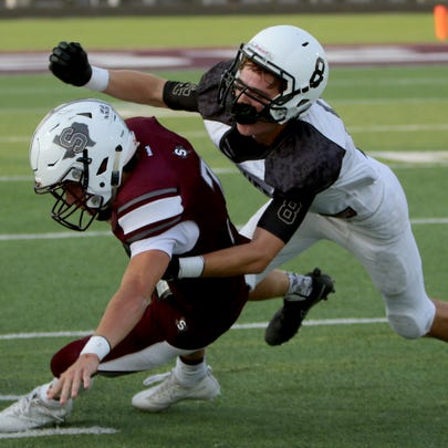 Seymour's Cade Holden is tackled by Archer City's Conner