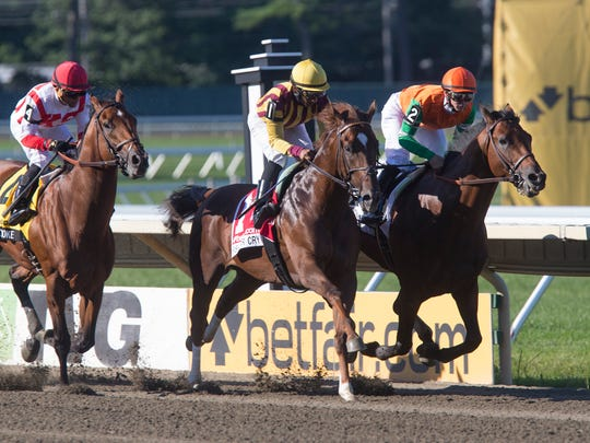 Out of the gate, Irish War Cry and Battle of Midway jockey for position during the 2107 Haskell.