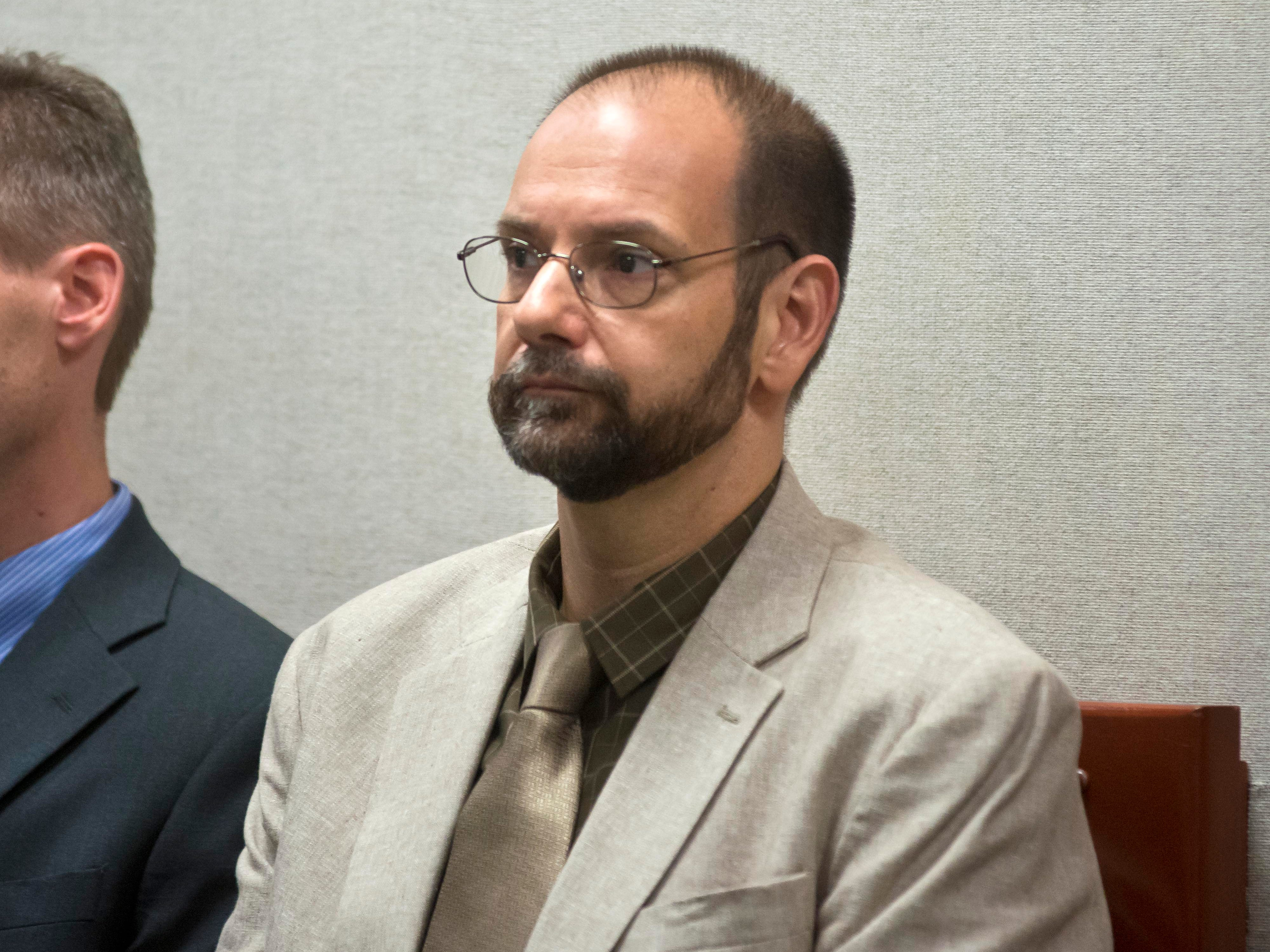 John Barone, superintendent of the Milton Town School District, looks on as five former Milton High School football players accused of hazing are arraigned Tuesday on charges of simple assault in Vermont Superior Court in Burlington.