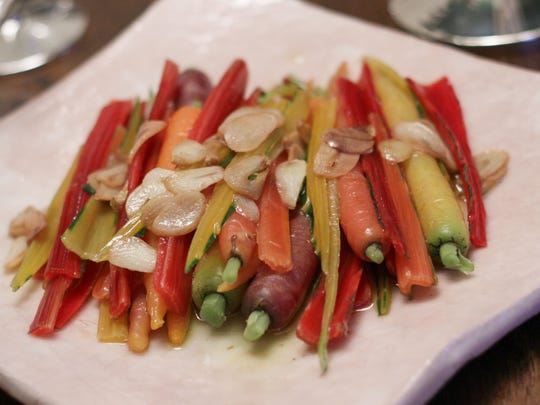 Anticipate spring with a light and colorful side dish of blanched rainbow Swiss chard stems and rainbow carrots, boiled and then tossed with sauteed garlic, olive oil and Champagne vinaigrette.