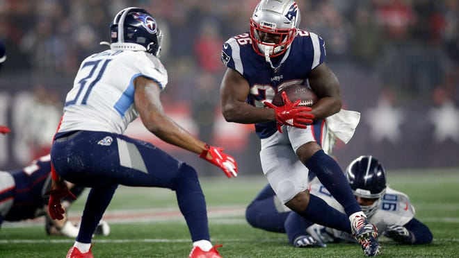New England Patriots running back Sony Michel (26) runs against Tennessee Titans free safety Kevin Byard (31) during the second quarter at Gillette Stadium.