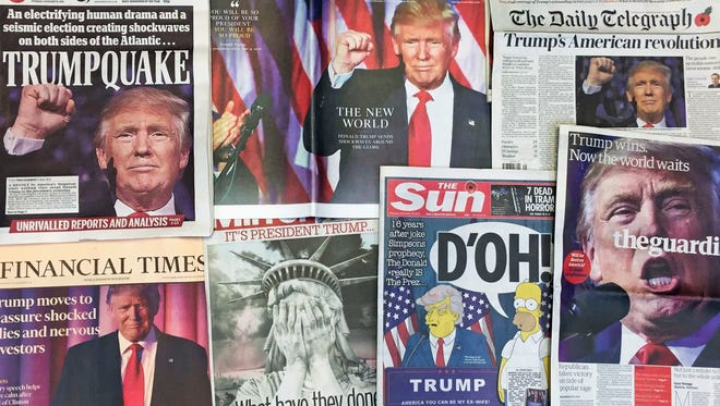 FILE - This Thursday, Nov. 10, 2016 file photo shows the front pages of various British newspapers in London reporting on Donald Trump winning the U.S. presidential election.