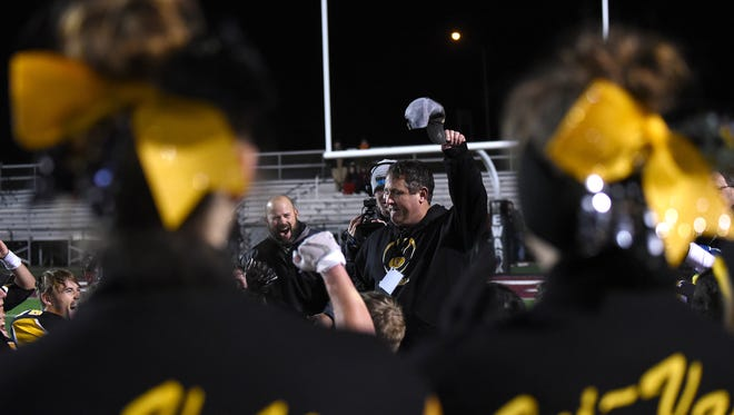 Tri-Valley head coach Justin Buttermore huddles with his team and coaching staff post game after defeating Bishop Hartley 13-9 in Friday night's regional final at White Field in Newark. Buttermore has taken Tri-Valley to the postseason 10 of the past 12 years with the Scotties making their first final four this season.