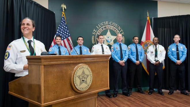 Lt. Erin Boyajian (far left) gives remarks after a swearing in ceremony for her and seven other St. Lucie County Fire District firefighter/paramedics on Wednesday, January 4, 2017, at the St. Lucie County Sheriff's Office in Fort Pierce. The group, including Mark Elliott (from left), Paul Valerio, Lt. Michael Ascani, Matt Coney, Jonathan Fraga, Lt. Satchelle Peterkin and Chris Bickford, completed special law enforcement training that allows them to serve as medics on the St. Lucie County Sheriff's Office SWAT team. Boyajian is the first female St. Lucie Sheriff's SWAT member.